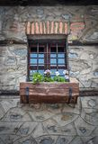 Old Vintage Window With Iron Bars And Flowers In The Pot royalty free stock photo