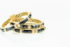 Old vintage women gold bracelet with black colored precious ston Stock Photography