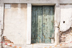 Old vintage wood door with old green window Royalty Free Stock Photography