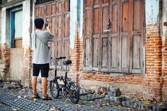 Old vintage wood door wood texture Old brick wall  Bicycle tourists Bicycle touring attractions Old house over 230 years old.bangk Stock Photography