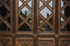 Old vintage wooden brown door close-up with glass Stock Photography