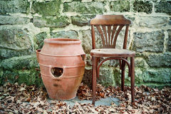 Old vintage wooden chair and amphora Royalty Free Stock Photo