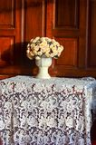 Old vintage wooden chair with table and vase Stock Photography