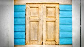 Old Vintage Wooden Closed Window on Cyan Plank Wall Stock Photos