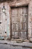 Old vintage wooden door in Old Town in decay Stock Images