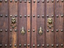 Old vintage wooden door ornate. With a beauty metal furniture. Close up royalty free stock photography