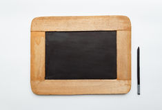 Old vintage  wooden frame blank slate and pencil. On white background Royalty Free Stock Photo