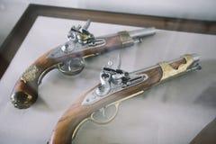 Old vintage wooden guns on a shower case. Old vintage wooden guns on a showercase Stock Photography