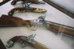 Old vintage wooden guns on a shower case. Old vintage wooden guns on a showercase Royalty Free Stock Photography