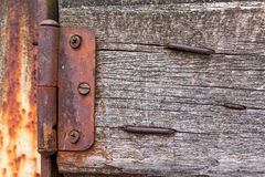 Old vintage wooden hinge on a fence with nails Stock Images