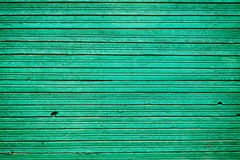 Old vintage wooden planks with emerald color paint, wall wood for background Stock Image