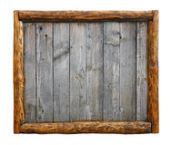 Old vintage wooden planks with log border frame. Old vintage wooden grunge gray aged rustic planks bulletin board panel with wood log border frame, copy space in Stock Images