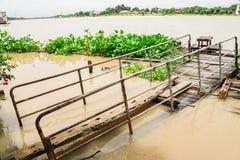 Old vintage wooden sheet bridge to Chaophraya river Royalty Free Stock Image