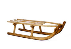Old vintage wooden sled on white royalty free stock photos
