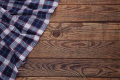 Old vintage wooden table with a red checkered tablecloth. Top view mockup. Stock Photos