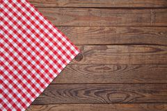 Old vintage wooden table with a red checkered tablecloth. Top view mockup. Old vintage wooden table with a red checkered tablecloth. Top view mock up stock image