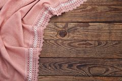 Old vintage wooden table and tablecloth with lace. Top view mockup. Stock Photography