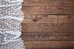 Old vintage wooden table with white tablecloth with lace. Top view mockup. Stock Photos