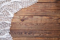 Old vintage wooden table with white tablecloth with lace. Top view mockup. Old vintage wooden table with white tablecloth with lace. Top view mock up Stock Images