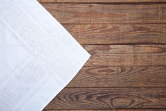 Old vintage wooden table with white tablecloth. Top view mockup. Stock Image