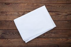 Old vintage wooden table with white tablecloth. Top view mockup. Stock Photo