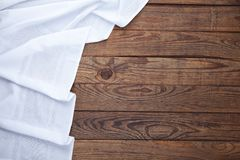 Old vintage wooden table with white tablecloth. Top view mockup. Stock Images