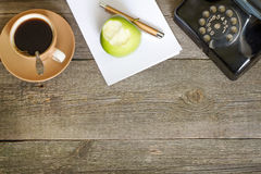Old vintage wooden table in workplace business office Royalty Free Stock Photos