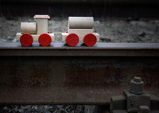 Old vintage wooden toy train. On  the real rails Stock Photos
