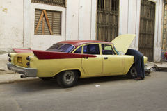 Old vintage Yellow Cuban Car. Old yellow vintage Cuban Car parke on street in Havana, Cuba Stock Image