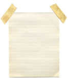 Old vintage yellowing notepaper. Old vintage yellowing notepaper stuck to a white background Stock Photos