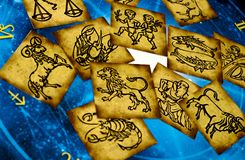 Old vintage zodiac cards with horoscope like astrology concept. Old vintage zodiac signs lying on horoscope like astrology magic, mystical, esoteric concept in stock images
