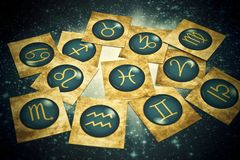 Old vintage zodiac cards with horoscope like astrology concept. Old vintage zodiac signs lying on horoscope like astrology magic, mystical, esoteric concept in stock photography