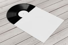Old Vinyl Record Disk in Blank Paper Case with Free Space for Yo. Ur Design on a wooden table. 3d Rendering Royalty Free Stock Photos