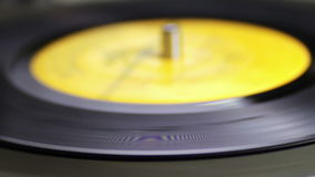 Old Vinyl Record Playing. Macro shot of old vinyl recording rotating in vintage player. Good for record player, gramophone, party, DJ, music, and more. Turntable stock video