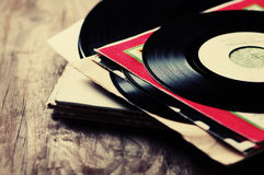 Old vinyl record. On the wooden table, selective focus and toned image Royalty Free Stock Image