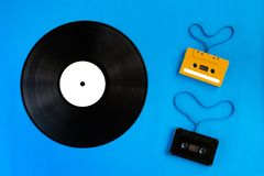 Old vinyl records and audio cassette tape with film shape heart royalty free stock images