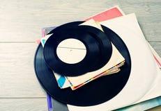 Old vinyl records. On wooden background. Vinyl, retro Stock Photography