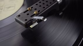 Old vinyl turntable playing music. Vintage vinyl turntable playing music stock video footage