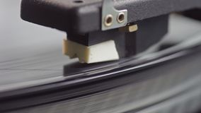 Old vinyl turntable playing music. Vintage vinyl turntable playing music stock video