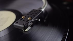 Old vinyl turntable playing music. Vintage vinyl turntable playing music stock footage