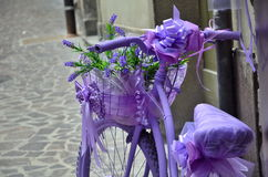 Old violet bicycle on street Royalty Free Stock Photos