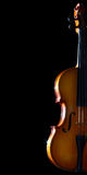 Old violin. Old violin isolated on black background. Vertical image Royalty Free Stock Photo