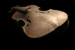 Old violin. On the black background Royalty Free Stock Image