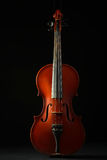 Old violin. Beautiful old violin on a black background Royalty Free Stock Images