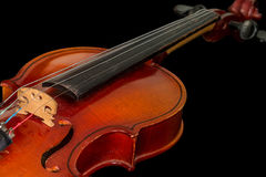 Old violin on a black background. A musical stringed instrument for musical performance Royalty Free Stock Photo