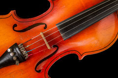 Old violin on a black background. A musical stringed instrument for musical performance Royalty Free Stock Photography