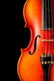 Old violin on a black background. A musical stringed instrument for musical performance Royalty Free Stock Images