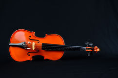 Old violin. On on black silk fabric Royalty Free Stock Photo