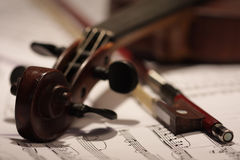 Old violin and bow. Old master violin with bow and note background Royalty Free Stock Image