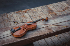 Old violin with the bow Stock Photo